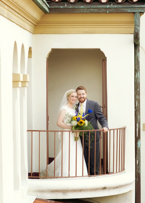 Bride and groom on the balcony of Villa Del Sol, Fullerton CA